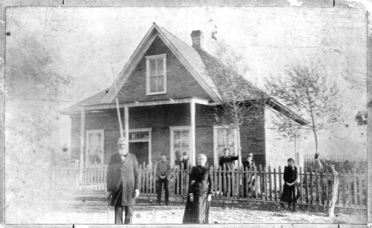 William Mann Rudd and Eliza Catherine (Mann) Rudd with family at their home in Springerville, Arizona (Aft. 1886)